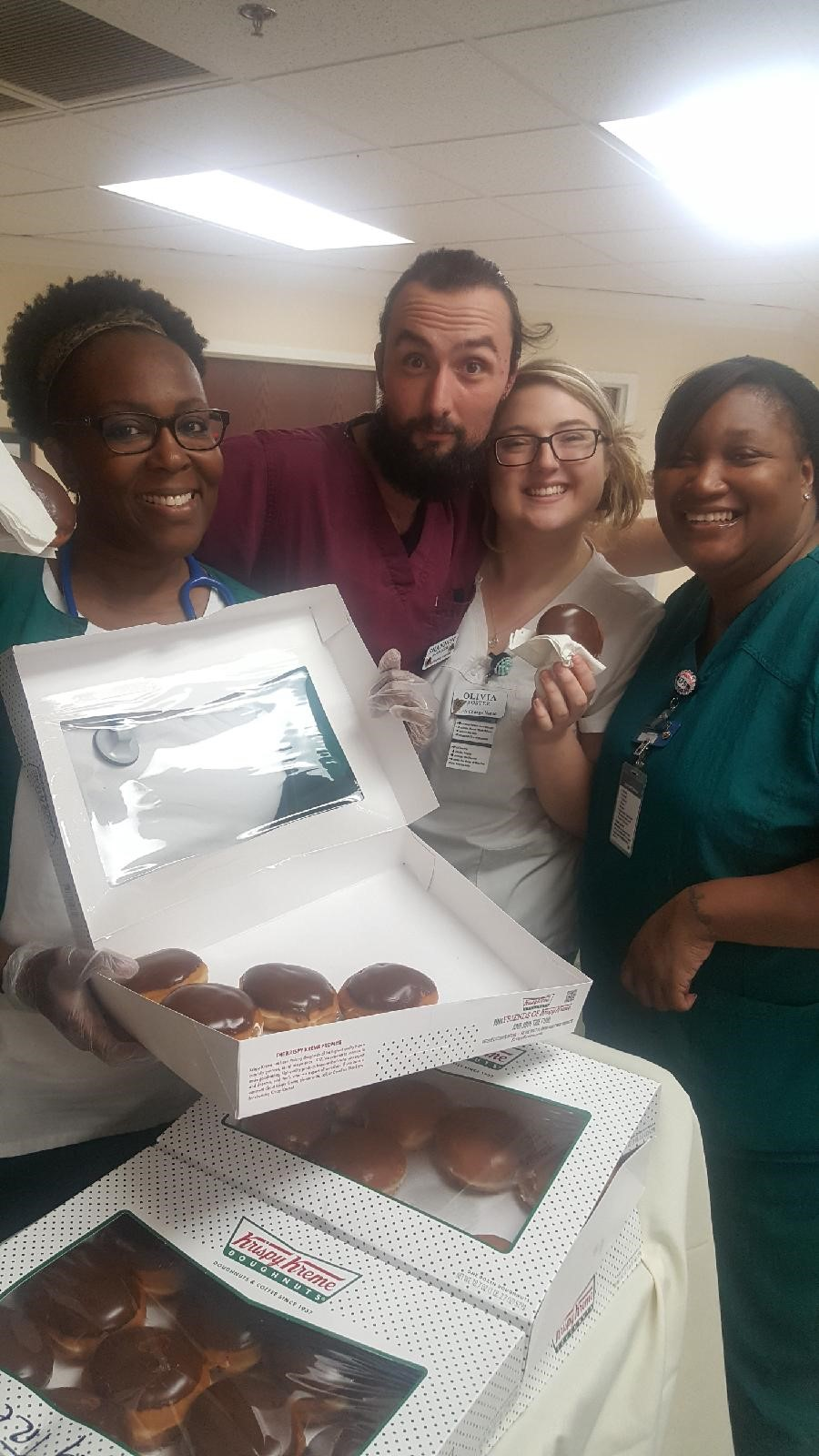 Springtree team celebrating National Cream Filled Donut Day