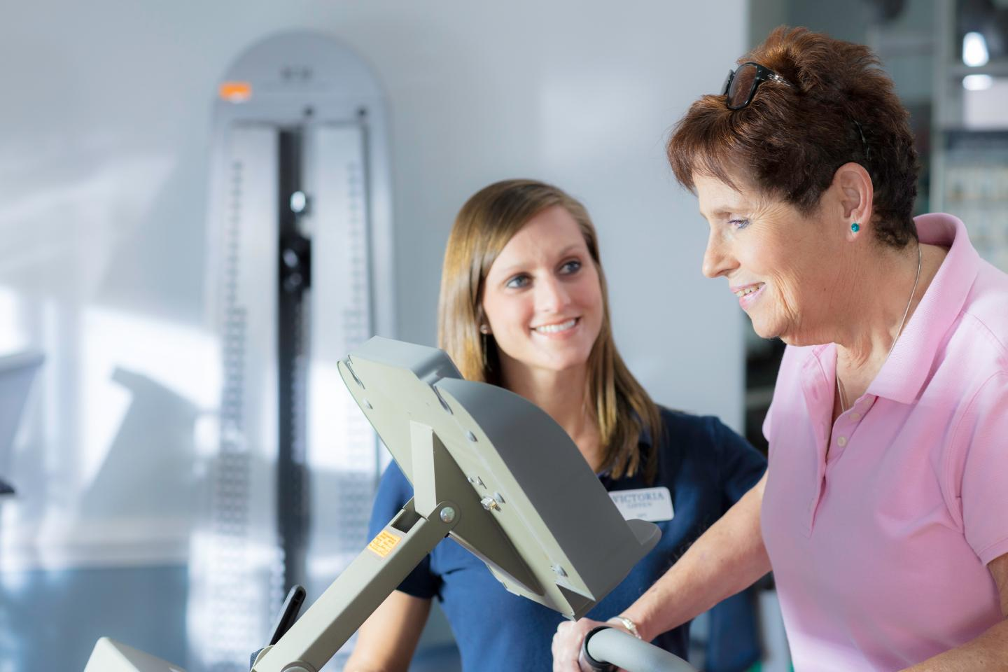 Ann with a therapist in our LifeWorks Rehab gym